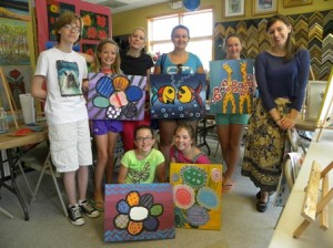 Owner Kristen Young (third from left, back row) poses with budding artists at The Painted Pink Cat. (Photo/J. G. Naras)