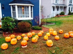 Lit pumpkins line the front lawn of the Tevekelian family home in Shrewsbury.