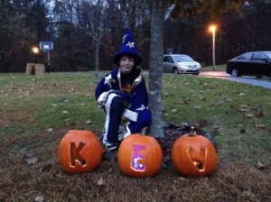 Kev's oldest son Andrew in costume with pumpkins spelling out his father's name.