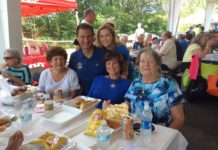 Sheriff Lew Evangelidis (back, left) with guests at last year's senior picnic Photo/submitted