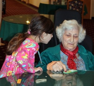 Bianca Agiomavritis, 6, speaks to Mona Hakim.