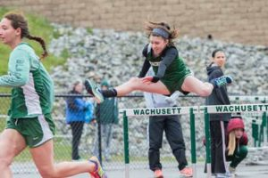 HURDLES: Wachusett left in photo: Amanda Mailberg (Senior) and Abby McLean (Freshman)