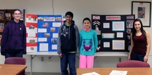 Eighth-graders (l to r) Peter Kunz, Vikram Pathalam, Jenny Chen and Emily Lapomardo stand by their projects. (Photo/Rebecca Kensil)
