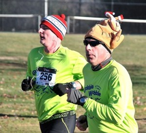 John Doyle and Tim Daloisio of Southborough approach the finish line.