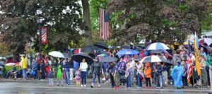 A good sized crowd hoisted umbrellas and donned rain gear to watch the Memorial Day ceremonies in Shrewsbury. Photo/Joyce DeWallace