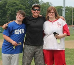 MYBA General Manager Peter Scerra (center) celebrates with Special Olympians.