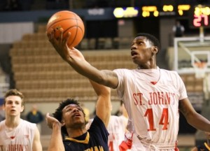Adham Floyd goes up for a layup during the second quarter of Tuesday's game.