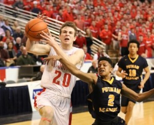 Joseph Murphy (left) is fouled by Keiayvin Hayes (right) as he drives to the basket.