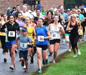 Runners and walkers start the Northborough Stands Together Against Bullying 5K Run/Walk in 2011. The fourth annual run/walk will be held Saturday, Oct. 5, at 9 a.m., beginning and ending at Melican Middle School. (File photo/Ed Karvoski Jr.)