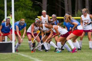 Algonquin players (white) surge in front of the North Middlesex goal.  Megan Holmes (left) scored on the play.