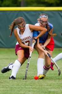 Algonquin junior Taylor Long battles for the ball against a North Middlesex player.