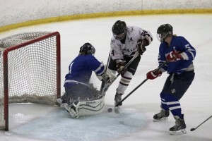 Julieanne Sacco (24) tries to sneak the puck past the Leominster goalie.
