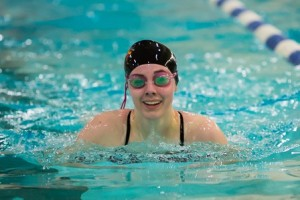 Westborough's Bonnie Nolan swims the breaststroke leg of the 200-yard individual medley at the Midland-Wachusett League Invitational Championships. (Photo/Jeff Slovin)