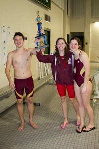 Algonquin captains Max Ludwig, Carly Railing, and Megan Murray hoist their team's second-place trophy.