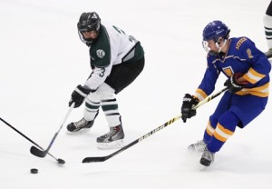 Brendan Coates (left) and Alex McConnell (right) battle for puck possession.