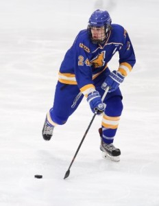 Assabet's Ernie Jones looks to connect with a teammate as he skates up the ice.
