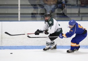 Michael Najemy (left) tries to skate past Zach Magarian (right).