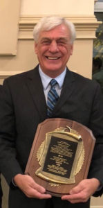 Det Klein displays his plaque as an inductee of the International Candlepin Bowling Association Hall of Fame.