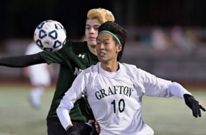 Grafton's #10 Fred Zheng battles with Nipmuc's Jonas Walter for possession of the ball.