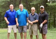 Greg Tresaloni (left) and colleagues at Panera Bread participate in last year's golf tournament to benefit the Boys & Girls Clubs of MetroWest. Photo/submitted
