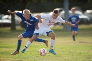 #17 Nate Murphy of the Hawks jumps in between the ball and Lunenburg player #7 David Gardner to steal possession.