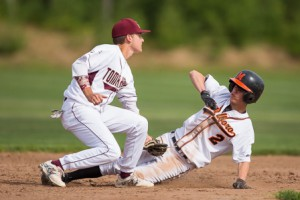 Algonquin's Eric Hart tags out Marlborough's Peter Benjaminsen as he attempts to steal second base.