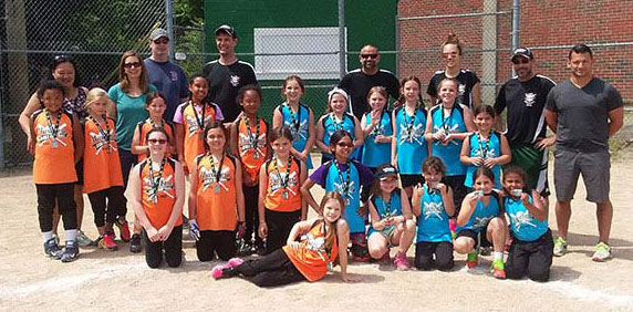 """Junior League team ages 7-9 pose for a photo at their last game of the season on the """"big field"""" Baldelli"""