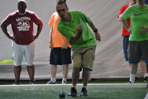 A competitor throws a bocce ball. Photos/Dakota Antelman
