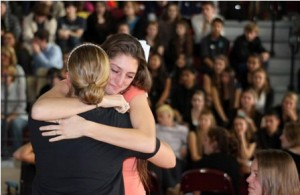 Algonquin High School student Danielle Fucci gives a hug to teacher Renee Moulton during the often-emotional assembly.
