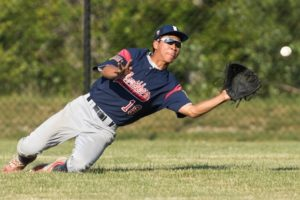 Northborough's Jason Lu makes a sliding catch in the outfield