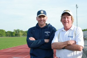 Shrewsbury High School coaches Kurt Gustafson (left) and Jim Smith at the school track. (Photo/Mary Pritchard)