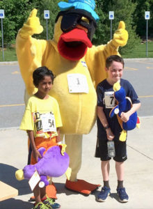 Dexter the Camp Wonder Duck stands with the two youngsters who finished first in the 2017 race. Photo/submitted