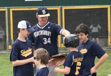 Shrewsbury High School varsity baseball player Joe West with Challenge League players