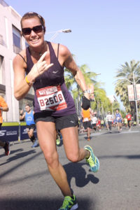 Signaling to her fans, Jaime Gosselin has fun on the course of the Los Angeles marathon in 2016. Photo/submitted