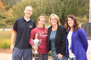 (l to r) Matt Travis of Athletic Revolution; Ali Rheaume, 2014 Women's Overall Winner; Amber Bock, superintendent of Westborough Public Schools; and Andrea Cote, manager, PR Running Photo/Ellen Bishop