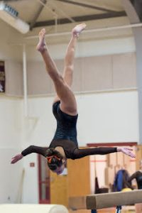 Marlborough's Jacqueline McKinnon eyes her landing in mid-dismount from the balance beam during the meet against Westborough.