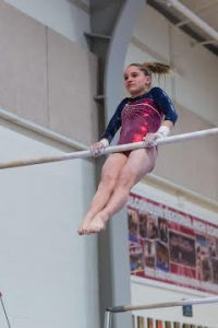 Westborough's Madison Bromm completes her transitions from the low bar to the high bar during her performance.