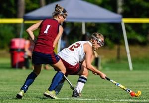 Algonquin Regional High School's Molly Dore (#12) keeps the ball away from Westborough High School's Samantha Weckwerth (#1), left.