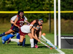 Algonquin Regional High School's Grace Grimaldi (#7) front, tries to get a shot off against the defense of Westborough High School's Erin Moore (#9) behind, Ashley Solares (#12), and Catherine DiSaia (Goalkeeper).