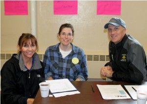(l to r) Bernie Sex and team captains Aileen Lemoine and Bill Sex register and check in parishioners for the Day of Service.