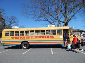 Kids could play in the mini gymnasium inside Tumblebus, one of the event sponsors.