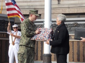 Westborough's grand marshal, Douglas Sulham, accept a handmade quilt from Beverly Linnane. The quilt was made by local members of the Schoolhouse Quilters on behalf of the Quilts of Valor Foundation, a national organization that has provided over 90,000 hand-crafted quilts to veterans.