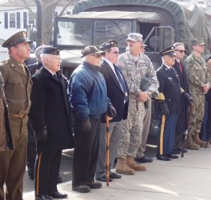 Veterans stand at attention at the ceremony held at the FMB.