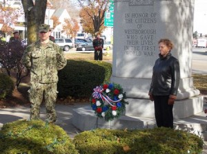 Douglas Sulham, the grand marshal and Selectman Leigh Emery, pay tribute at the World War 1 Memorial.