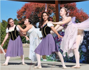 Students from Dance It Up perform a routine on the bandstand.