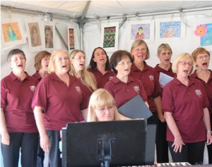 """Members of the Westborough Community Chorus sing the Everly Brothers hit """"Bye Bye Love"""" from its spring show """"Harmony Family Style."""""""