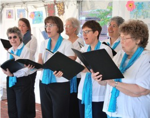Members of the Hundredth Town Chorus sing a number from its 65th anniversary concert.