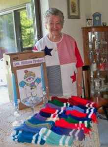 Joan Ames stands beside many of the mittens she made and donated to the Westborough 300th Committee 300 Mittens drive.
