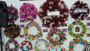 An array of wreaths for sale, many with a Westborough theme