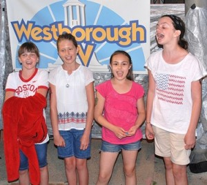 Singing as a quartet at the Westborough TV booth are (l to r) Maddie Reinach, 10; Alyssea Immonen, 10; Nikki Farmer, 11; and Shannon Hackett, 11.